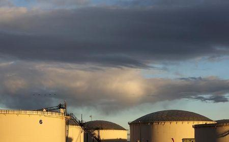 Crude oil storage tanks are seen at the Kinder Morgan terminal in Sherwood Park
