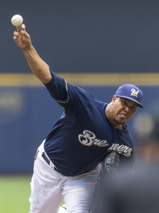 Milwaukee Brewers' Wily Peralta pitches to a St. Louis Cardinals batter during the first inning of a baseball game Sunday, July 13, 2014, in Milwaukee. (AP Photo/Tom Lynn)