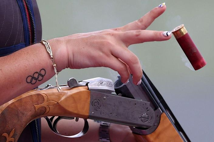 <p>The United States's Kayle Browning reloads her gun during the trap women's qualification.</p>