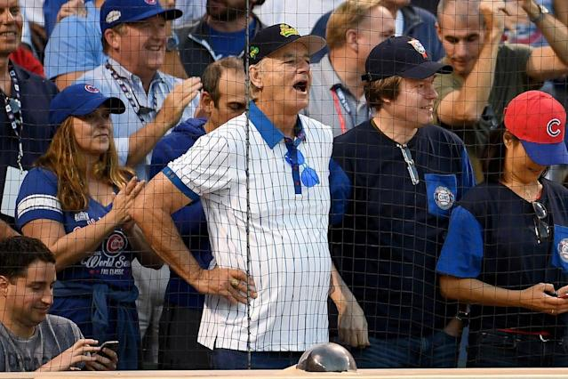 "<p>The <a href=""https://sports.yahoo.com/bill-murray-might-play-joe-maddon-cubs-world-series-movie-232238910.html"" data-ylk=""slk:Chicago Cubs fan;outcm:mb_qualified_link;_E:mb_qualified_link"" class=""link rapid-noclick-resp newsroom-embed-article"">Chicago Cubs fan</a> cheered on his team, even leading ""Take Me Out to the Ball Game"" during the seventh-inning stretch, at a playoff game against the Washington Nationals at Wrigley Field. And he brought good luck: The team ended up winning 2-1! (Photo: Getty Images) </p>"