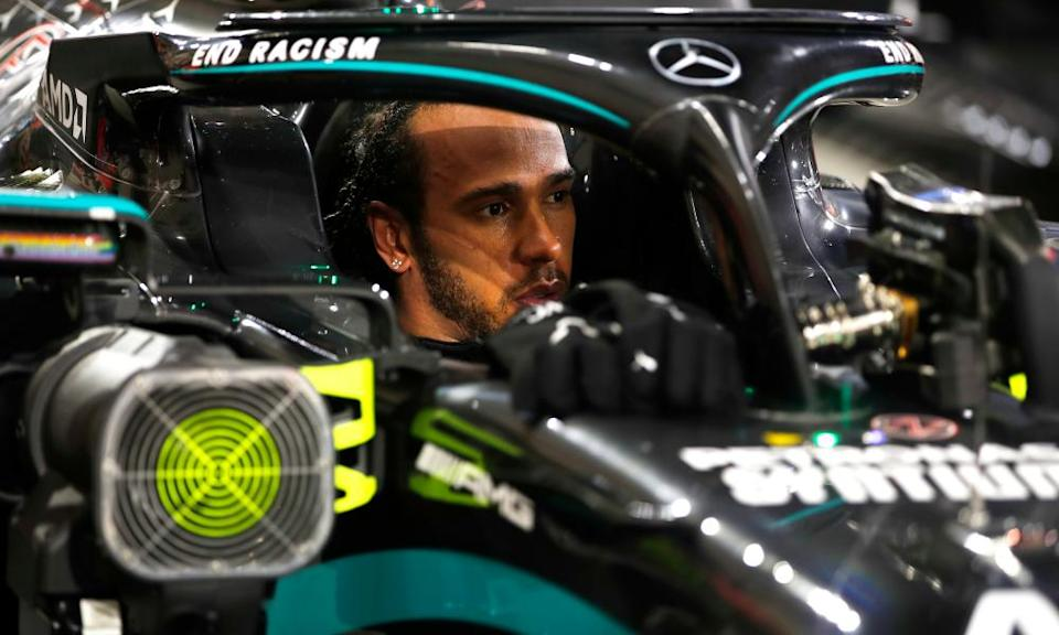 Lewis Hamilton looks reserved after his victory beneath his car's halo