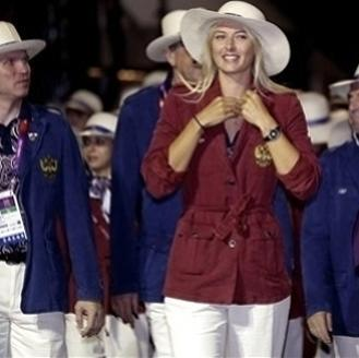 Tennis player Maria Sharapova, center, leads the Russian delegation during the Opening Ceremony at the 2012 Summer Olympics, Friday, July 27, 2012, in London. (AP Photo/Julio Cortez)