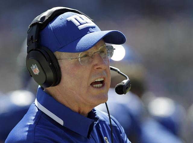New York Giants head coach Tom Coughlin looks on during the first half of an NFL football game against the Carolina Panthers in Charlotte, N.C., Sunday, Sept. 22, 2013. (AP Photo/Bob Leverone)