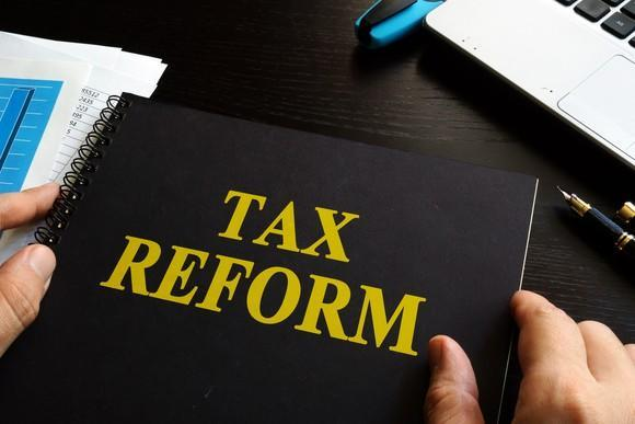 Black notebook with tax reform written on cover in yellow letters.