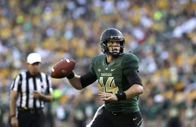 Baylor quarterback Bryce Petty (14) passes during the first half of an NCAA college football game against SMU Sunday, Aug. 31, 2014, in Waco, Texas. (AP Photo/LM Otero)