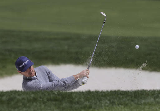 Justin Rose, of England, hits out of a bunker on the ninth hole during a practice round for the PGA Championship golf tournament, Wednesday, May 15, 2019, at Bethpage Black in Farmingdale, N.Y. (AP Photo/Charles Krupa)