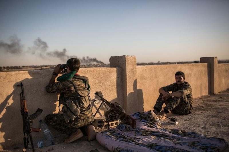Islamic State group fighters fired missiles containing toxic gas at Kurdish forces, pictured, in Syria last month, the forces and a monitoring group said (AFP Photo/Uygar Onder Simsek)