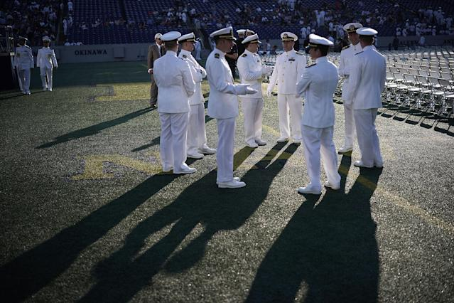 <p>Members of the U.S. Navy wait for the beginning of a U.S. Naval Academy graduation ceremony at the Navy-Marine Corps Memorial Stadium May 25, 2018 in Annapolis, Maryland. More than a thousand students graduated from the Naval Academy this year. (Photo: Alex Wong/Getty Images) </p>