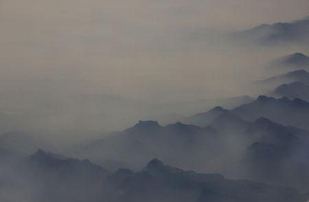 Heavy smog is seen among the mountains from an aircraft, over north China's Hebei province