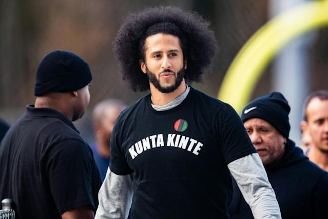 Colin Kaepernick has defended protesters who took to the streets in Minneapolis following the death of an unarmed black man during an arrest by police (AFP Photo/Carmen Mandato)