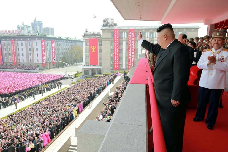 An official Korean Central News Agency image shows leader Kim Jong-Un waving to people after the military parade in Pyongyang on on April 16, 2017