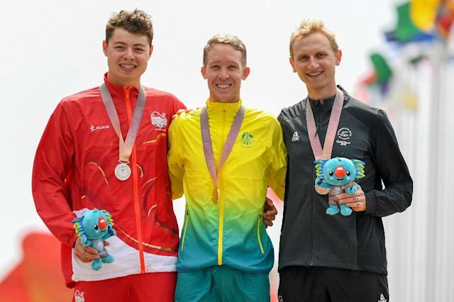 Gold medallist Cameron Meyer (centre), Harry Tanfield (left) and New Zealand's bronze medallist Hamish Bond (bronze) (AFP Photo/WILLIAM WEST)