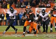 Cleveland Browns quarterback Austin Davis (7) scrambles in the second half against the Baltimore Ravens at FirstEnergy Stadium. The Ravens won 33-27. Mandatory Credit: Aaron Doster-USA TODAY Sports