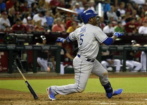 Los Angeles Dodgers Juan Uribe (5) follows through on an RBI single in the fourth inning during a baseball game against the Arizona Diamondbacks on Monday, July 8, 2013, in Phoenix. (AP Photo/Rick Scuteri)
