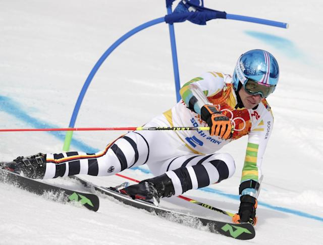 Germany's Felix Neureuther passes a gate in the first run of the men's giant slalom at the Sochi 2014 Winter Olympics, Wednesday, Feb. 19, 2014, in Krasnaya Polyana, Russia. (AP Photo/Charles Krupa)