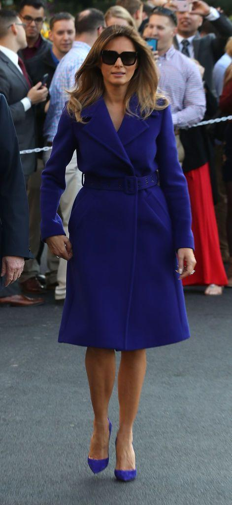 <p>Boarding Marine One for President Trump's 11-day tour of Asia, Melania wore a blue coat dress which was belted at the waist, and a pair of pumps of the same color.</p>
