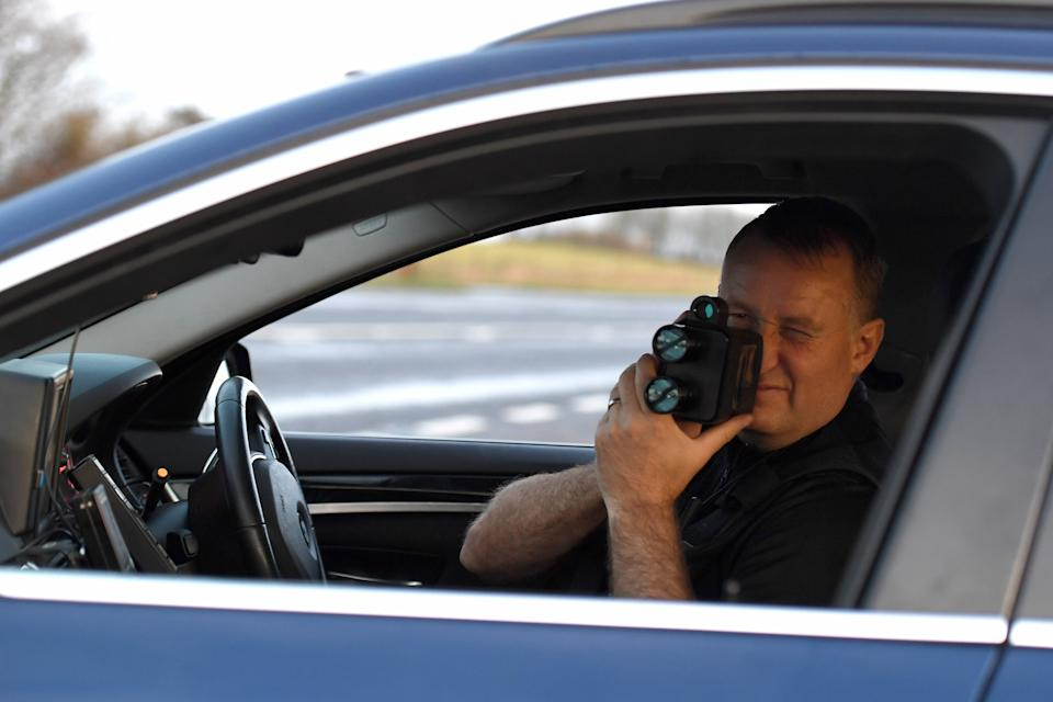 WEYMOUTH, ENGLAND - DECEMBER 06: Sgt. Jephcott from the No Excuse team uses a speed gun on the A35 as he patrols Dorset as part of the No Excuse campaign, on December 06, 2019 in Weymouth, England. The initiative is part of a force wide Christmas drink drive campaign with a fast-track policy of bringing drink drivers before a court within a week of the offence as well as the wider work of the No Excuse campaign. (Photo by Finnbarr Webster/Getty Images)