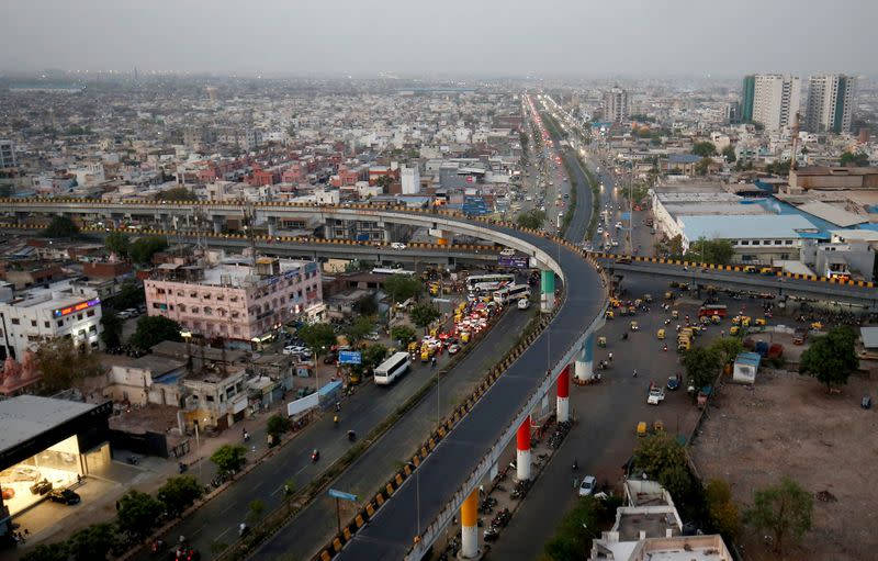 FILE PHOTO: Traffic moves along roads in Ahmedabad