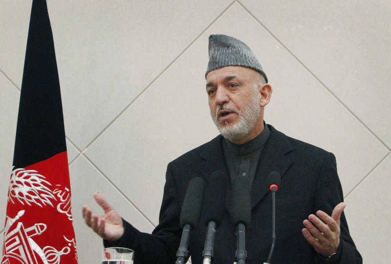 Afghan President Hamid Karzai speaks during a press conference at the presidential palace in Kabul, Afghanistan, Sunday, Feb. 26, 2012. Afghanistan's president renewed his calls for calm Sunday in a televised address to the nation after the burning of Qurans at a U.S. base sparked five days of deadly protests. (AP Photo/Musadeq Sadeq)