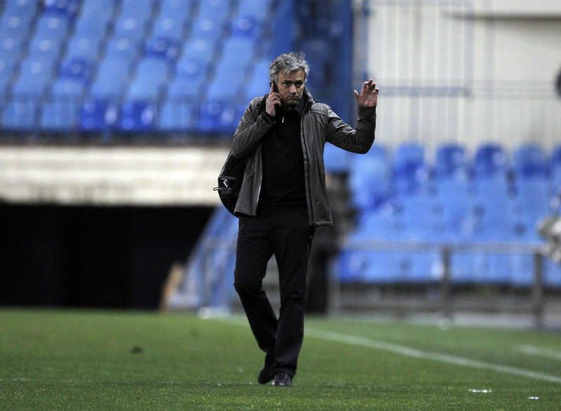 Real Madrid's coach Jose Mourinho from Portugal gestures as he leaves the stadium following a Spanish La Liga soccer match against Atletico de Madrid at the Vicente Calderon stadium in Madrid, Spain, Saturday, April 27, 2013. (AP Photo/Andres Kudacki)