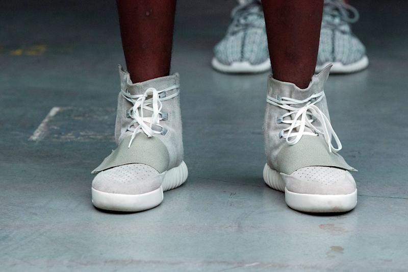 A model wears a pair of Adidas Yeezy 750 Boost shoes designed by Kanye West as part of his Fall/Winter 2015 partnership line with Adidas at New York Fashion Week, U.S. February 12, 2015. Picture taken February 12, 2015. REUTERS/Lucas Jackson/File photo