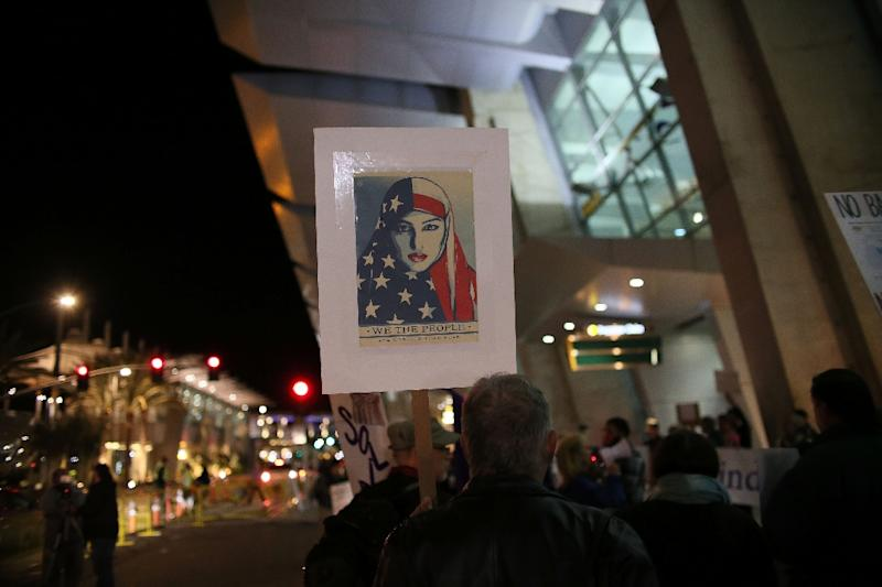 The United States has seen regular protests, as here in San Diego on March 6, against President Donald Trump's revised travel ban (AFP Photo/Sandy Huffaker)