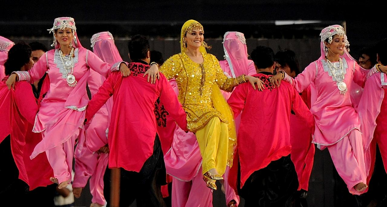 Bollywood actress Preity Zinta (C) performs during a ceremony before the IPL Twenty20 cricket match between Pune Warriors India and Kings XI Punjab at The Subrata Roy Sahara Stadium in Pune on April 8, 2012.