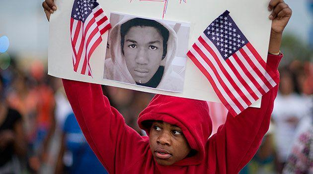 Jaylen Reese, 12, of Atlanta, marches to downtown during a protest of George Zimmerman's not guilty verdict in the 2012 shooting death of teenager Trayvon Martin. Photo: AAP