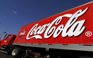 FILE - This Nov. 10, 2010 file photo shows a Coca-Cola delivery truck in Springfield, Ill. Coca-Cola reports quarterly financial results on Tuesday, Feb. 10, 2015. (AP Photo/Seth Perlman, File)