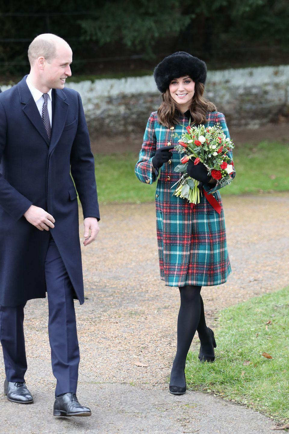 """<p>The Duchess wore a festive tartan peacoat by Miu Miu <a href=""""https://www.townandcountrymag.com/society/tradition/g14465780/royal-family-meghan-markle-christmas-church-photos-2017/"""" rel=""""nofollow noopener"""" target=""""_blank"""" data-ylk=""""slk:on Christmas day in 2017"""" class=""""link rapid-noclick-resp"""">on Christmas day in 2017</a> as she attended mass with the rest of the royal family. </p>"""