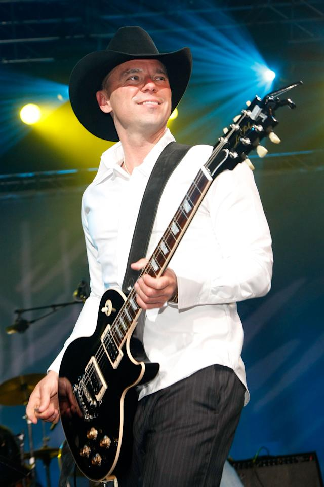 """Country singer <a target=""""_blank"""" href=""""http://news.yahoo.com/photos/performer-kenny-chesney-1317800764-slideshow/"""">Kenny Chesney</a> has played NFL football stadiums by the dozen, received 4 consecutive Academy of Country Music """"Entertainer of the Year"""" awards and sold more than 30 million albums. He will perform live on stage at """"A Decade of Difference: A Concert Celebrating 10 Years Of The William J. Clinton Foundation"""" on October 15.<br><br>(Photo by Ethan Miller/ACM2009/Getty Images for ACMA)"""