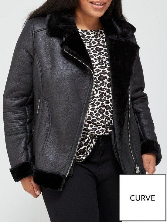 """<br><br><strong>V BY VERY CURVE</strong> Faux Shearling Biker Jacket In Black, $, available at <a href=""""https://www.littlewoods.com/v-by-very-curve-faux-shearling-biker-jacket-black/1600444443.prd?utm_campaign=content&awc=3089_1603358972_5159fd094dc9ca51817d51d6e60eba31&aff=awin&affsrc=79682&cm_mmc=awin-_-79682-_-Shopping+Directory-_-0_0&utm_source=awin&utm_medium=affiliate&utm_term=ShopStyle%20UK_79682&utm_content=na"""" rel=""""nofollow noopener"""" target=""""_blank"""" data-ylk=""""slk:Littlewoods"""" class=""""link rapid-noclick-resp"""">Littlewoods</a>"""