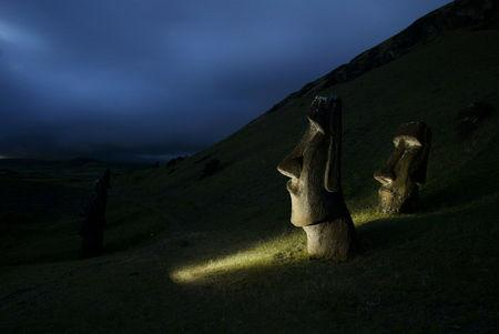 "FILE PHOTO: A view of ""Moai"" statues in Rano Raraku volcano, on Easter Island,  4,000 km (2,486 miles) west of Santiago, Oct. 31, 2003. Easter  Island's mysterious ""Moai"", giant head statues carved out of volcanic  rock, are in danger of being destroyed by years of tropical rains and  wind as well as careless humans and farm animals. Experts have called on the international community to commit funds to preserve the monoliths, whose mystery draws tourists to the world's most remote inhabited island. REUTERS/Carlos Barria"
