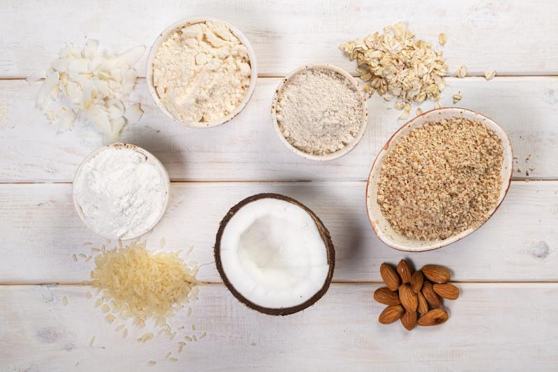 Gluten free concept - selection of alternative flours and ingredients, copy space