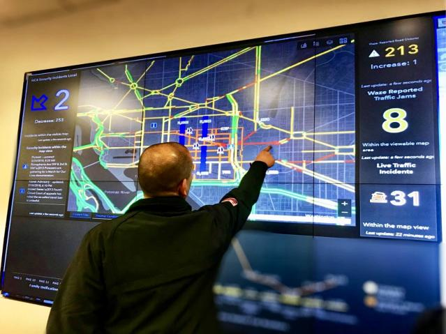 Chris Rodriguez, director of the D.C. Homeland Security and Emergency Management Agency, points to real-time traffic updates and other data being broadcast at the agency's command center ahead of the March for Our Lives rally in Washington, D.C. on March 24, 2018. (Photo: Caitlin Dickson/Yahoo News)