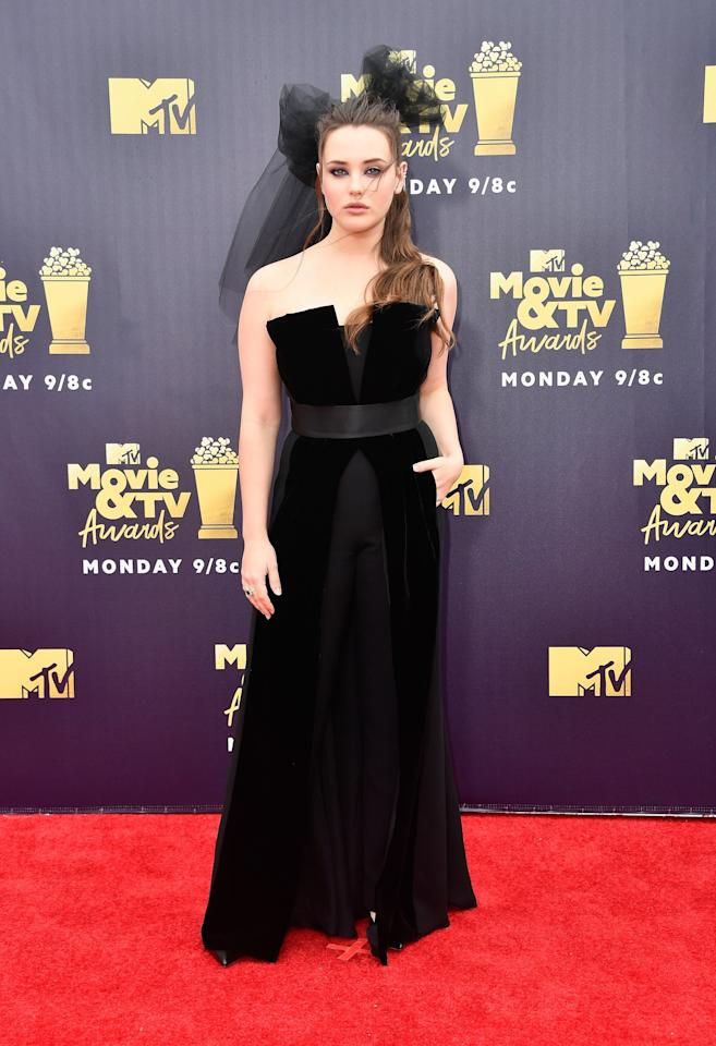 <p>Wearing a black Giorgio Armani gown with a matching headpiece and jewels by Borgioni and Narcisa Pheres.</p>