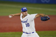 Israel's DJ Sharabi pitches during the fifth inning of a baseball game against the United States at the 2020 Summer Olympics, Friday, July 30, 2021, in Yokohama, Japan. (AP Photo/Sue Ogrocki)