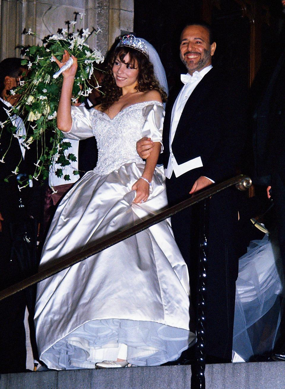 """<p>The over-the-top princess gown Carey wore for her 1993 wedding to Tommy Mottola is one of the most iconic celebrity wedding dresses of all time. But the marriage was an unhappy one, and <a href=""""https://www.youtube.com/watch?v=mrwbUvjIf4c"""" rel=""""nofollow noopener"""" target=""""_blank"""" data-ylk=""""slk:Carey eventually confessed on"""" class=""""link rapid-noclick-resp"""">Carey eventually confessed on </a><em><a href=""""https://www.youtube.com/watch?v=mrwbUvjIf4c"""" rel=""""nofollow noopener"""" target=""""_blank"""" data-ylk=""""slk:Watch What Happens Live"""" class=""""link rapid-noclick-resp"""">Watch What Happens Live</a> </em>that she considered burning it in her music video for """"We Belong Together."""" (<a href=""""https://www.youtube.com/watch?v=0habxsuXW4g"""" rel=""""nofollow noopener"""" target=""""_blank"""" data-ylk=""""slk:She ended up rewearing it instead, to run away with Wentworth Miller"""" class=""""link rapid-noclick-resp"""">She ended up rewearing it instead, to run away with Wentworth Miller</a>!)</p>"""