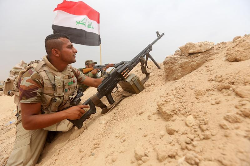 Iraqi Shiite fighters from the Popular Mobilization units hold a position on the Tharthar frontline on the edge of Anbar province on June 1, 2015