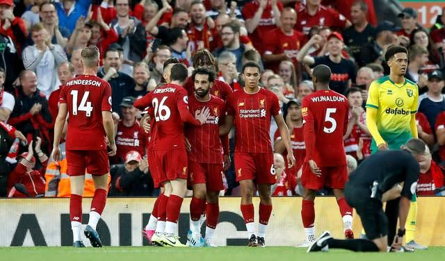 Liverpool, fresh from being crowned European champions, began the season in emphatic fashion by thrashing newly-promoted Norwich 4-1 at Anfield. An own goal from Grant Hanley, plus strikes from Mohamed Salah, Virgil Van Dijk and Divock Origi saw the Reds race into a four-goal half-time lead (Martin Rickett/PA)
