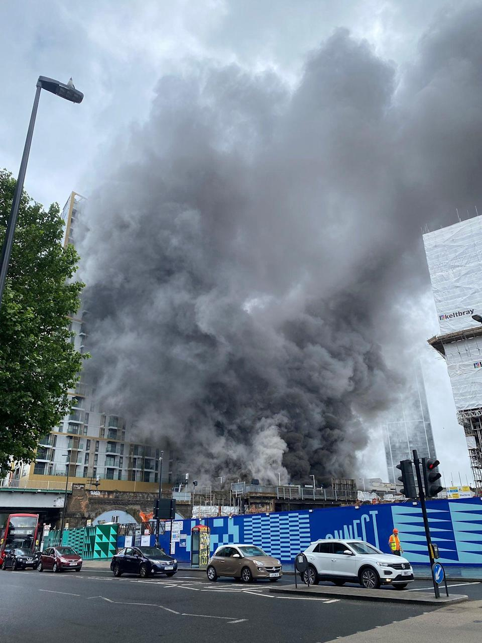 A massive plume of black smoke could be seen rising across the capital's skyline (@Unofficial_Phil)