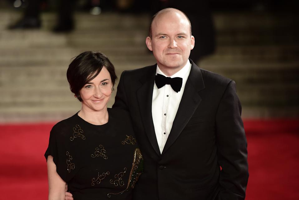British actor Rory Kinnear (R) poses on arrival for the world premiere of the new James Bond film 'Spectre' at the Royal Albert Hall in London on October 26, 2015. The film is directed by Sam Mendes and sees Daniel Craig play suave MI6 spy 007 for a fourth time.  AFP PHOTO / LEON NEAL        (Photo credit should read LEON NEAL/AFP via Getty Images)