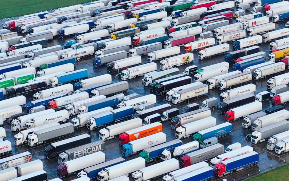 Freight Lorries and heavy goods vehicles (HGVs) are stacked at Manston Airport near Ramsgate, south east England on December 23, 2020, where freight transport was diverted to wait, after France closed its borders for 48 hours to contain the spread of new strain of coronavirus - WILLIAM EDWARDS/AFP
