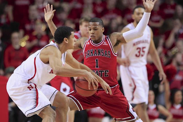 Nebraska's Tai Webster, left, is guarded by Arkansas State's Rakeem Dickerson (1) in the first half of an NCAA college basketball game in Lincoln, Neb., Saturday, Dec. 14, 2013. (AP Photo/Nati Harnik)