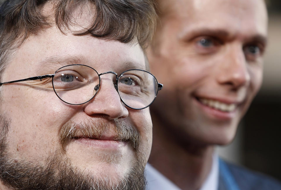 """Writer and director Guillermo del Toro, left, and actor Doug Jones pose on the press line at the premiere of the feature film """"Hellboy II: The Golden Army"""" in Los Angeles on Saturday, June 28, 2008. (AP Photo/Dan Steinberg)"""