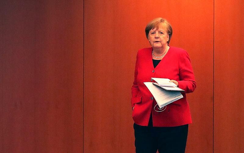German Chancellor Angela Merkel -The importance of the coronavirus R rate in other countries across the globe - GETTY IMAGES