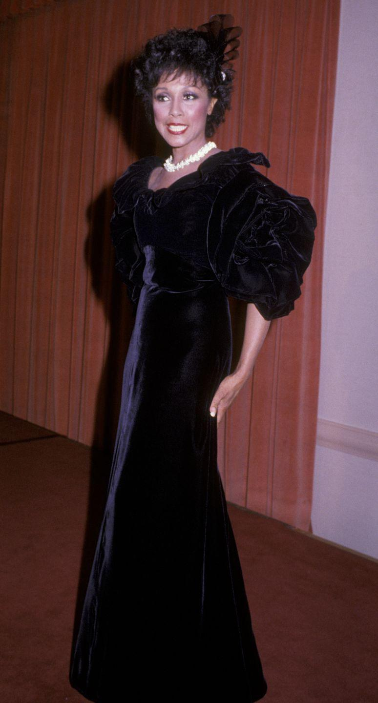 <p>In 1985, the actress, singer, and model topped off this floor-length velvet dress by wearing ribbons in her hair.</p>