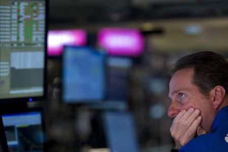 Specialist trader works on the floor of the New York Stock Exchange