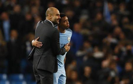 Britain Soccer Football - Manchester City v Manchester United - Premier League - Etihad Stadium - 27/4/17 Manchester City manager Pep Guardiola and Gabriel Jesus at the end of the match Action Images via Reuters / Jason Cairnduff Livepic