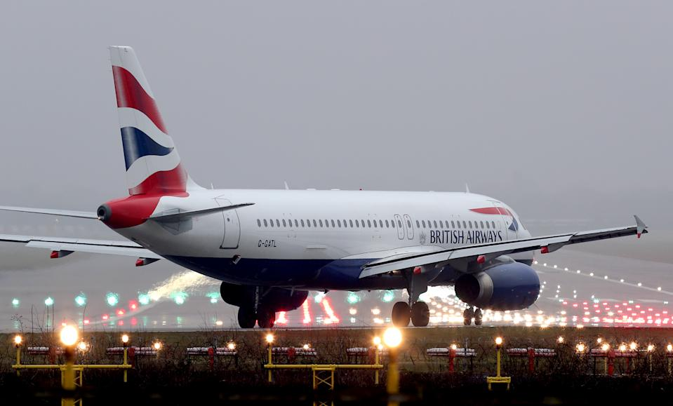 A British Airways Airbus A320-232 plane prepares to take off at Gatwick Airport in West Sussex.